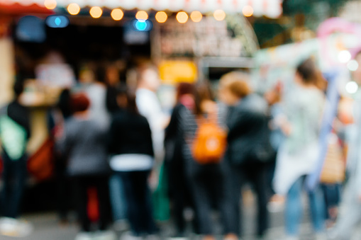 istock Row of unfocused people lining up to buy in a Food Truck 826782286