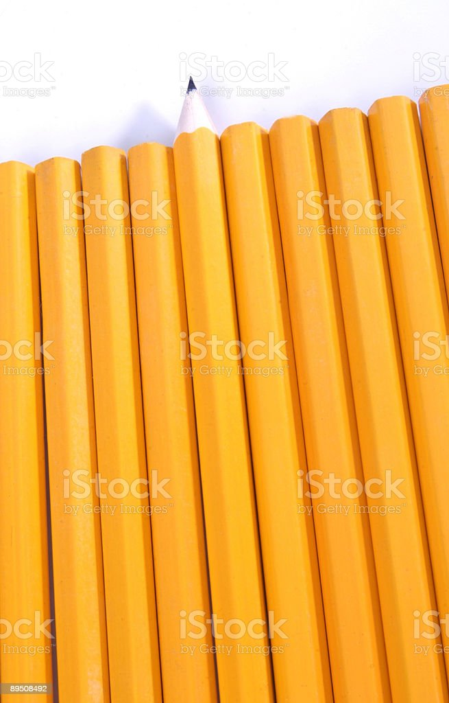 Row of unsharpened pencils with one sharpened pencil royalty-free stock photo