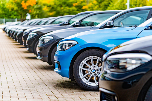 Hamburg, Germany - Oktober 04. 2020: A row of used BMW cars parked at a public car dealership in Hamburg, Germany. No people in this picture