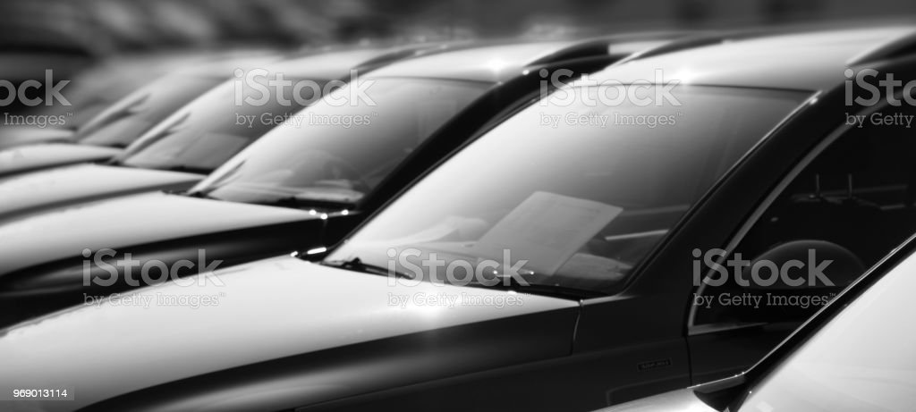 Row of used cars at a dealer - black and white stock photo