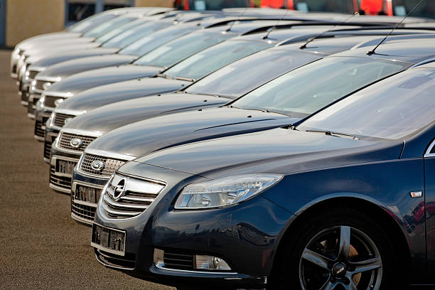 row of used ford cars at dealership - ford focus stock photos and pictures