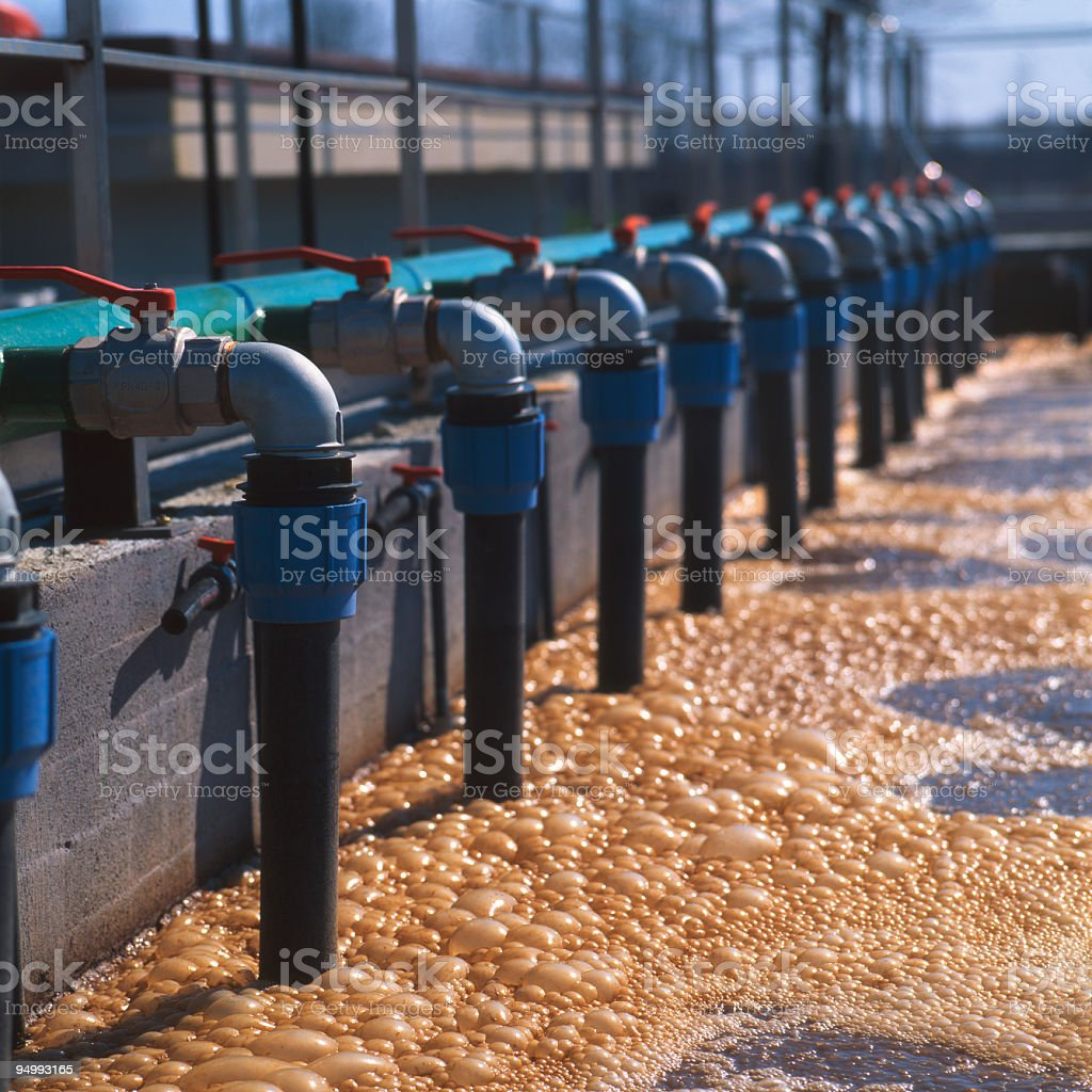 Row of valves in industrial sewage treatment plant stock photo