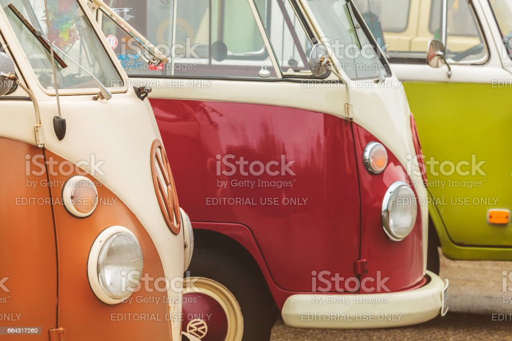 Row of vintage Volkswagen Transporter buses from the seventies