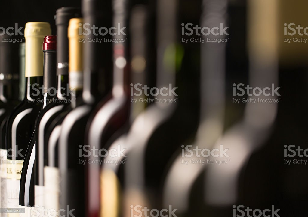 Row of vintage wine bottles stock photo