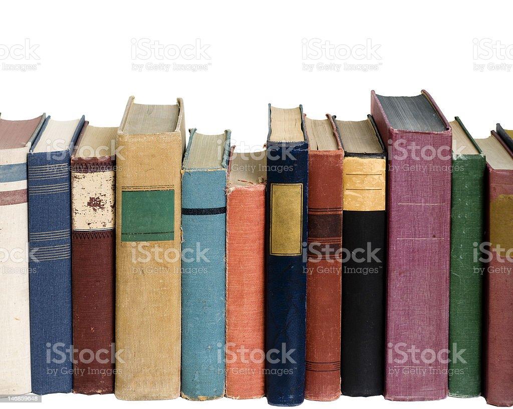 Row of vintage worn books stock photo