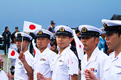 Row of walking japanese navy officers