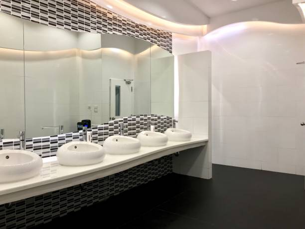 Row of wash sink and big mirror in public restroom stock photo