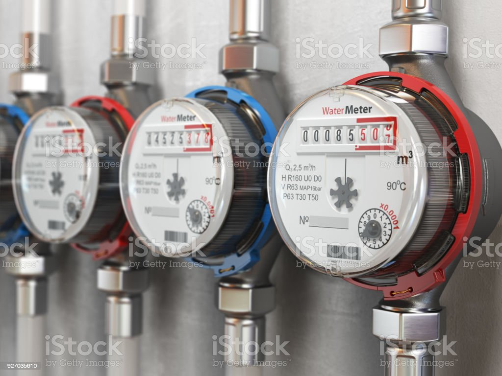 Row of water meters of cold and hot water on the wall background. stock photo