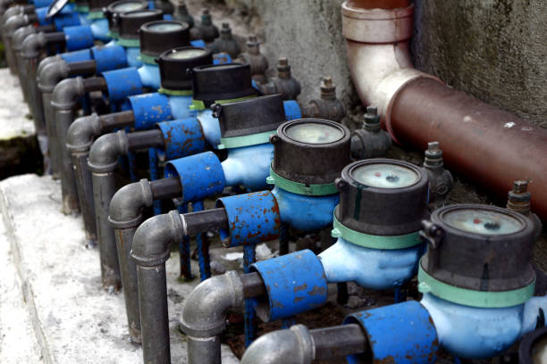 Row of water meters Photo of a row of water meters water wastage stock pictures, royalty-free photos & images