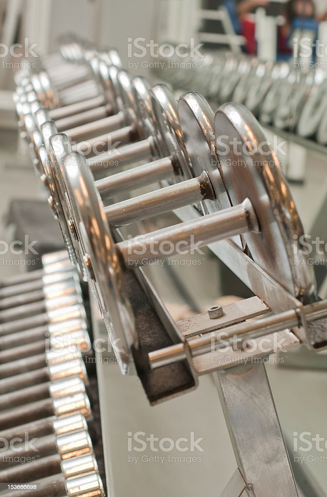 Row of weights at the gym stock photo