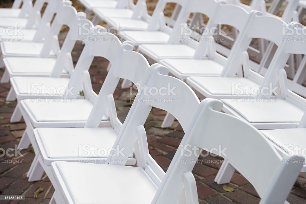 Row of White Chairs Set Up for Event Seating royalty-free stock photo