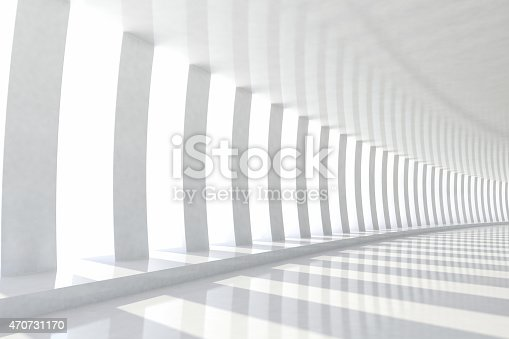 istock Row of white columns with sunlight in empty corridor space 470731170