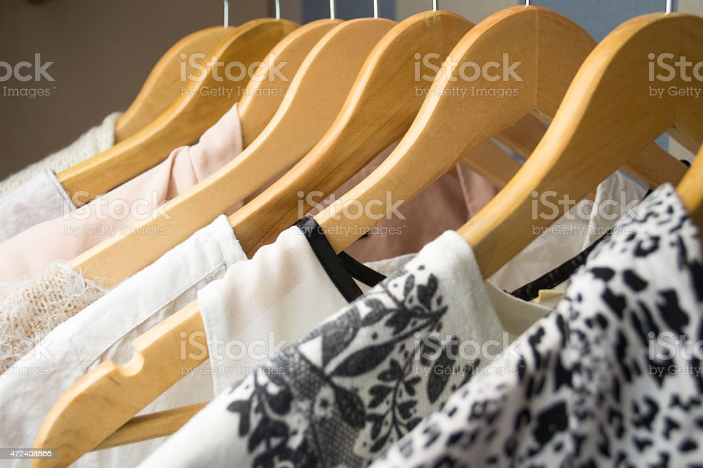 row of white dress in wardrobe at home stock photo