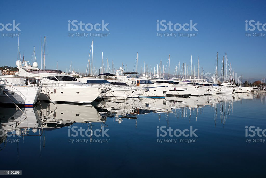row of white luxury yachts at mediterranean harbor stock photo