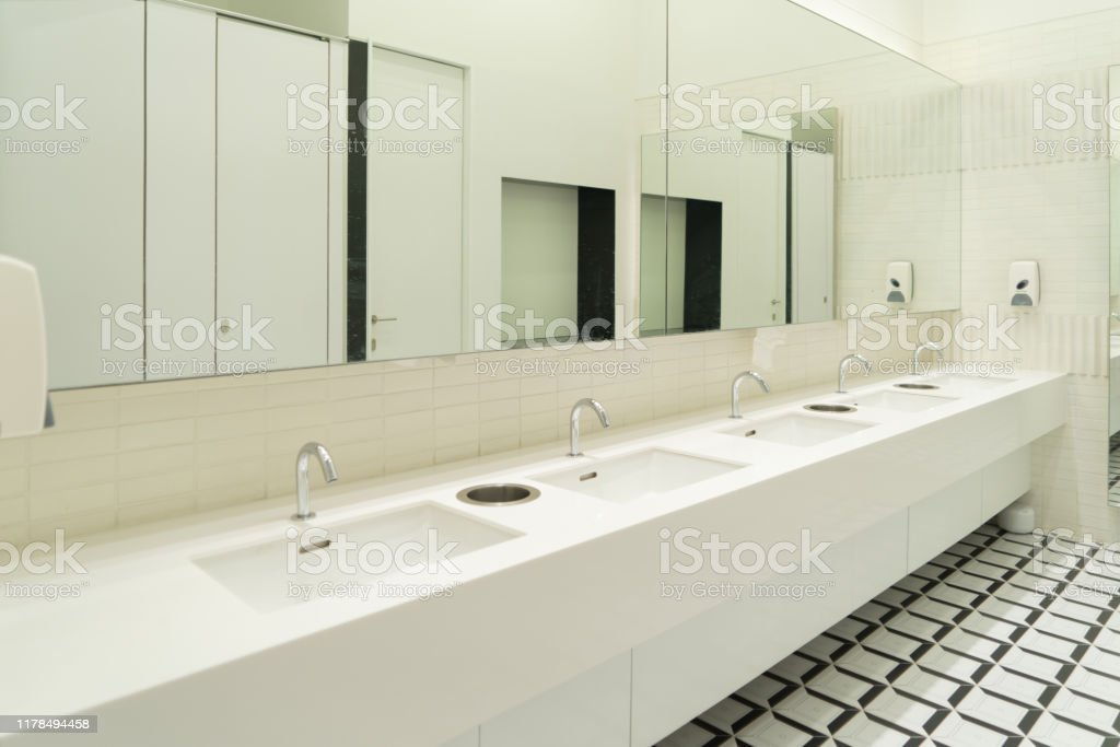 Row Of White Modern Marble Ceramic Wash Basin In Public Toilet Restroom In Restaurant Or Hotel Or Shopping Mall Interior Decoration Design Stock Photo Download Image Now Istock
