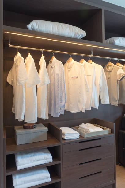 row of white shirts on rail stock photo