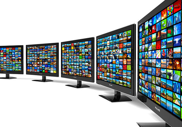 Row of widescreen HD displays wtih multiple images See also: cable tv stock pictures, royalty-free photos & images