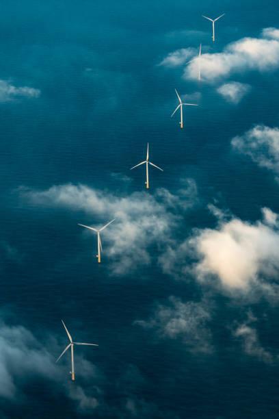 Row of wind turbines at sea stock photo