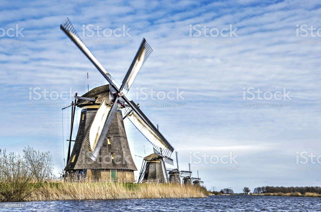 Row of windmills in Kinderdijk stock photo