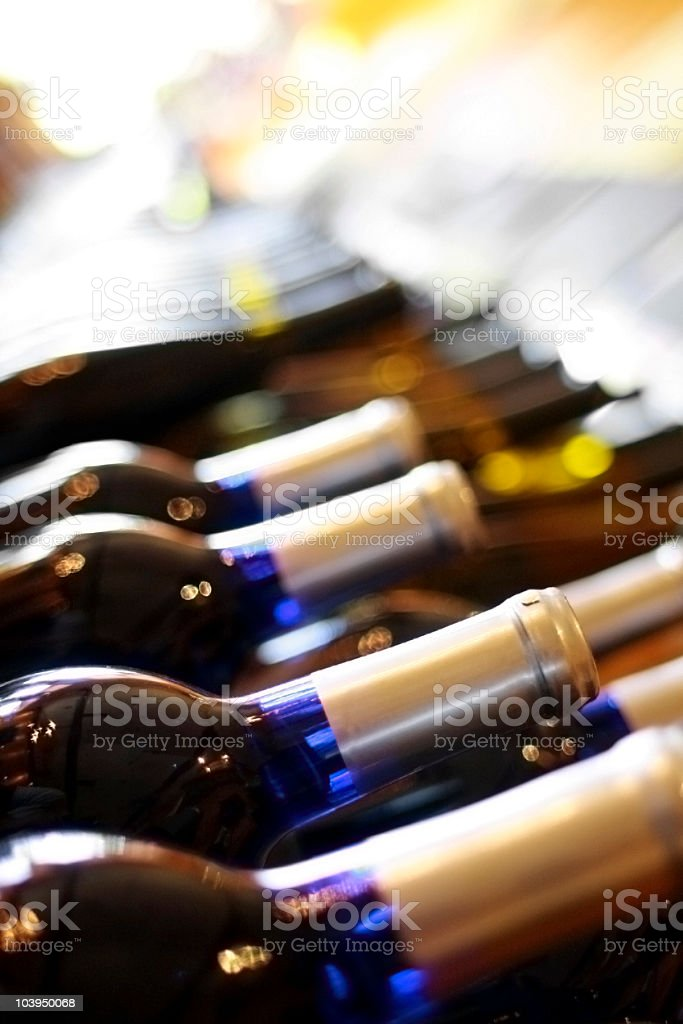 Row of Wine Bottles - Close Up With Shallow Focus royalty-free stock photo