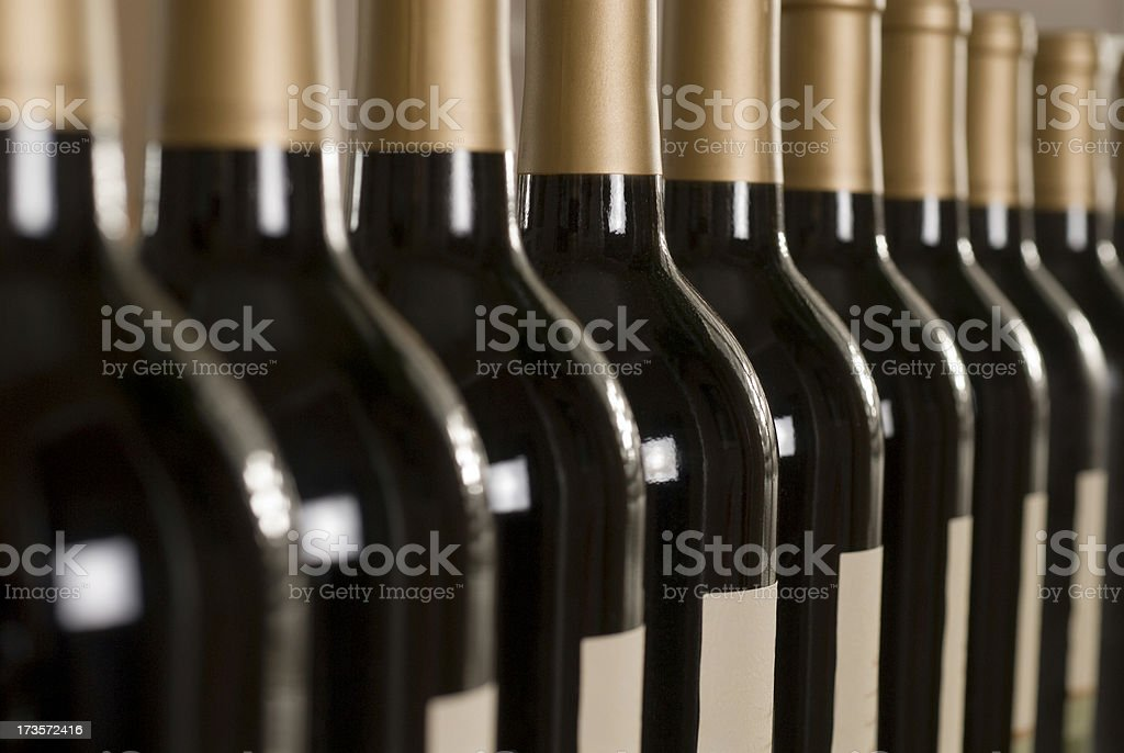 Row of wine bottles royalty-free stock photo