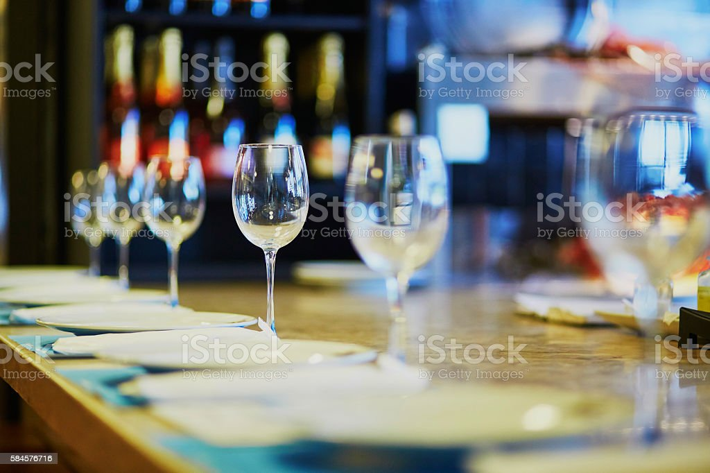 Row of wine glasses on the table stock photo