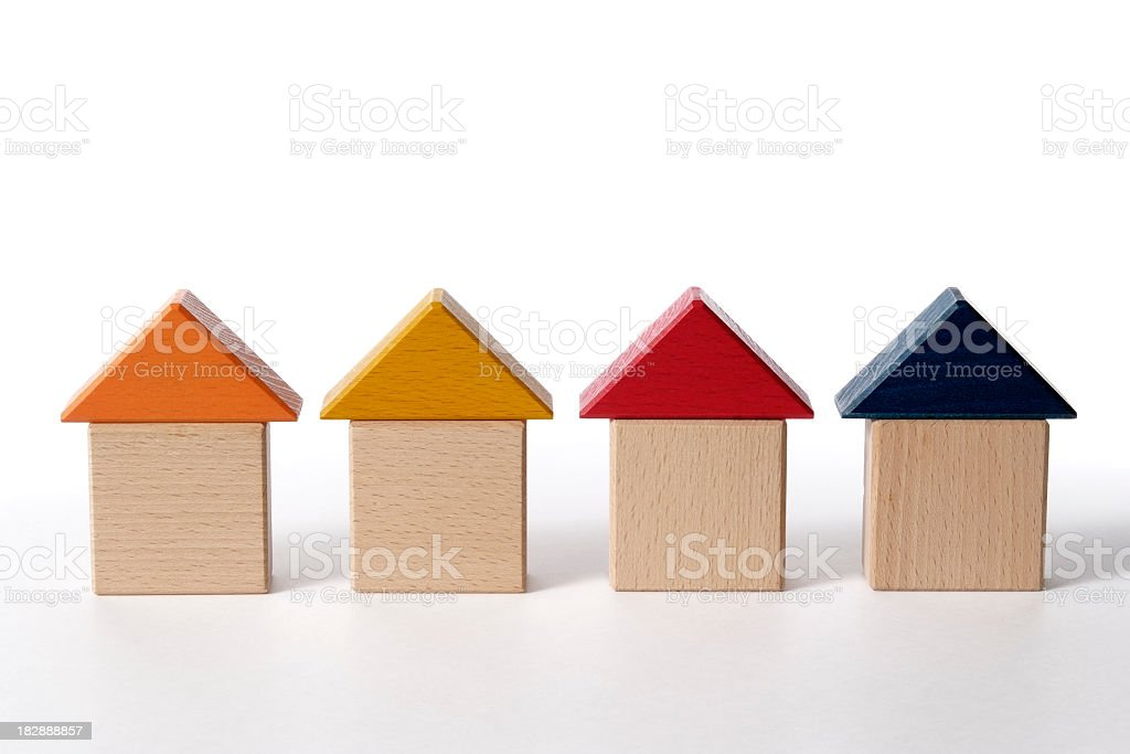 Row of wood block houses on white background royalty-free stock photo