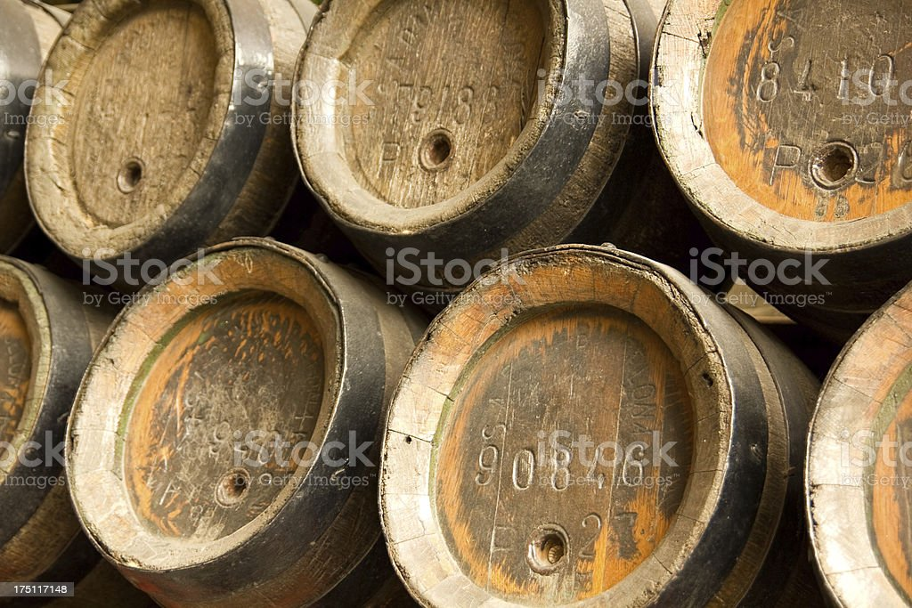 Row of wooden beer barrels stock photo
