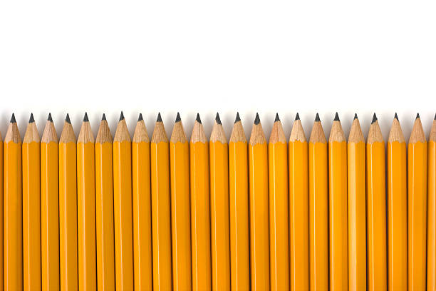 row of yellow pencils repetition for education on white background - 鉛筆 個照片及圖片檔