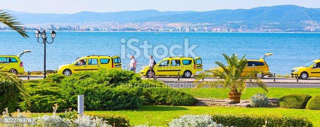 istock Row of yellow taxi cars and sea coast in Nessebar, Bulgaria 807276976