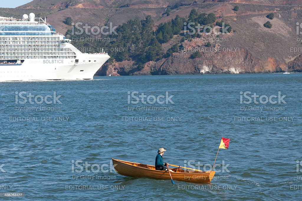 rowboat and cruise ship royalty-free stock photo