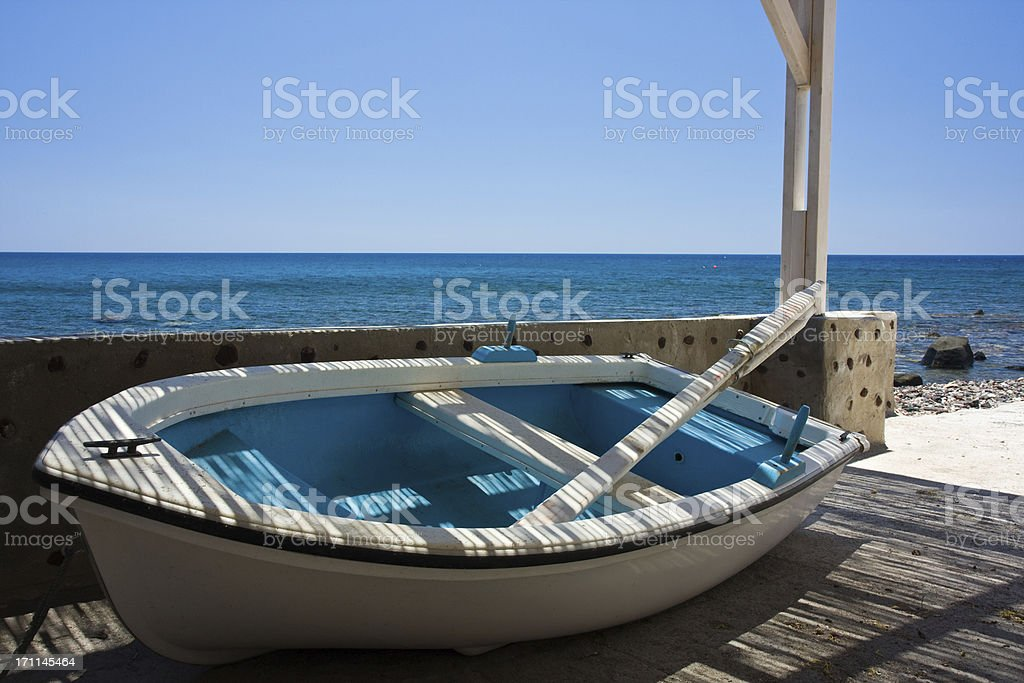 rowboat in shade royalty-free stock photo