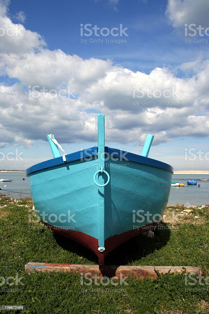 rowboat insiluetted in the sky royalty-free stock photo