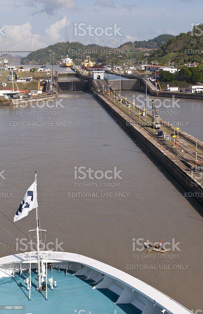 Rowboat meets Cruise Ship stock photo