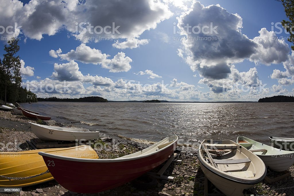 Rowboats and shore of lake in Finland royalty-free stock photo