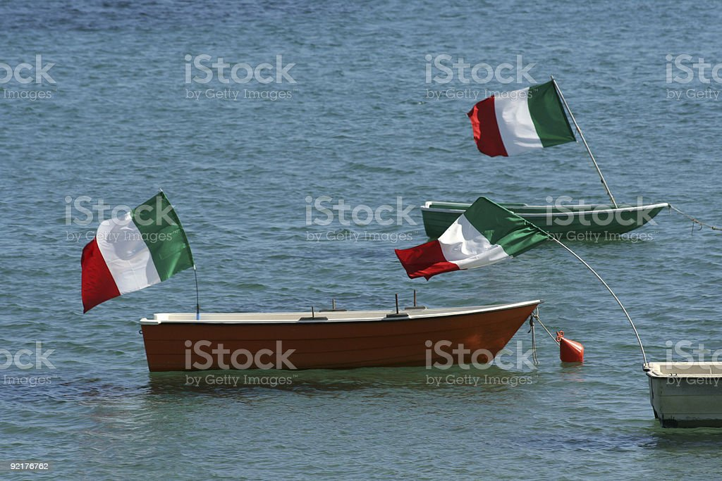 Rowboats decorated with italian flags royalty-free stock photo