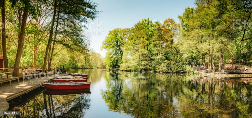 rowboats on stage at Neuer See in Berlin Tiergarten stock photo