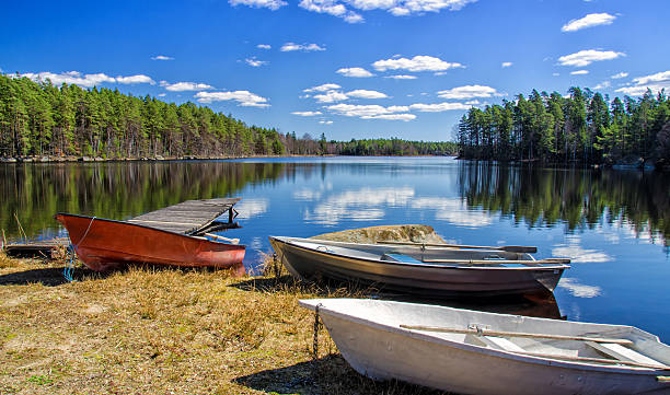 Rowboats on the Swedish lake coast stock photo