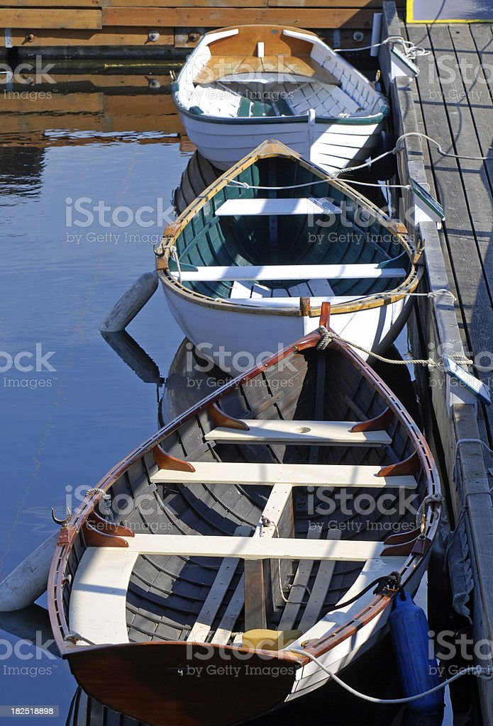 Rowboats tied to pier royalty-free stock photo