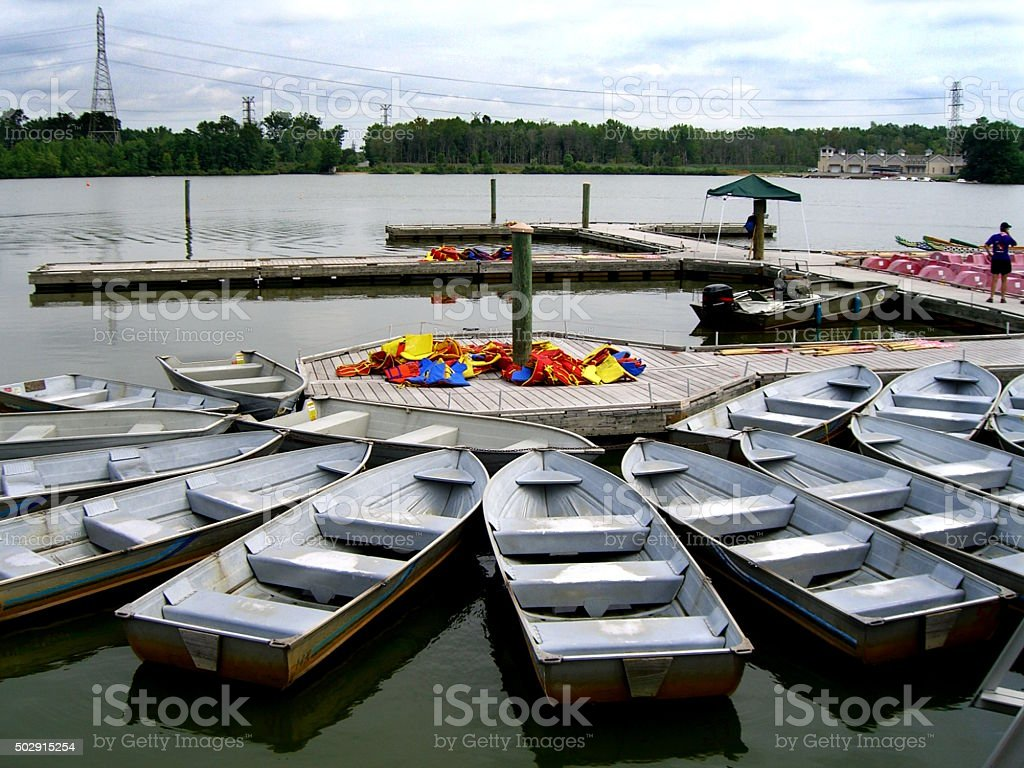 Rowboats tied to their Dock stock photo