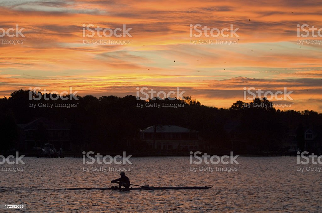 Rower at dawn stock photo