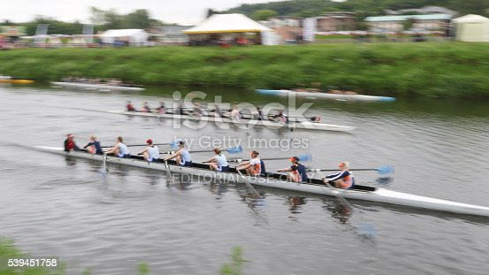 Durham, England - June 12, 2016: Two teams of eight rowers racing on the River Wear during the 183rd Durham Regatta. The regatta is the second oldest in England and attracts in excess of two thousand competitors including international entries,  with up to ten thousand spectators from across the United Kingdom.