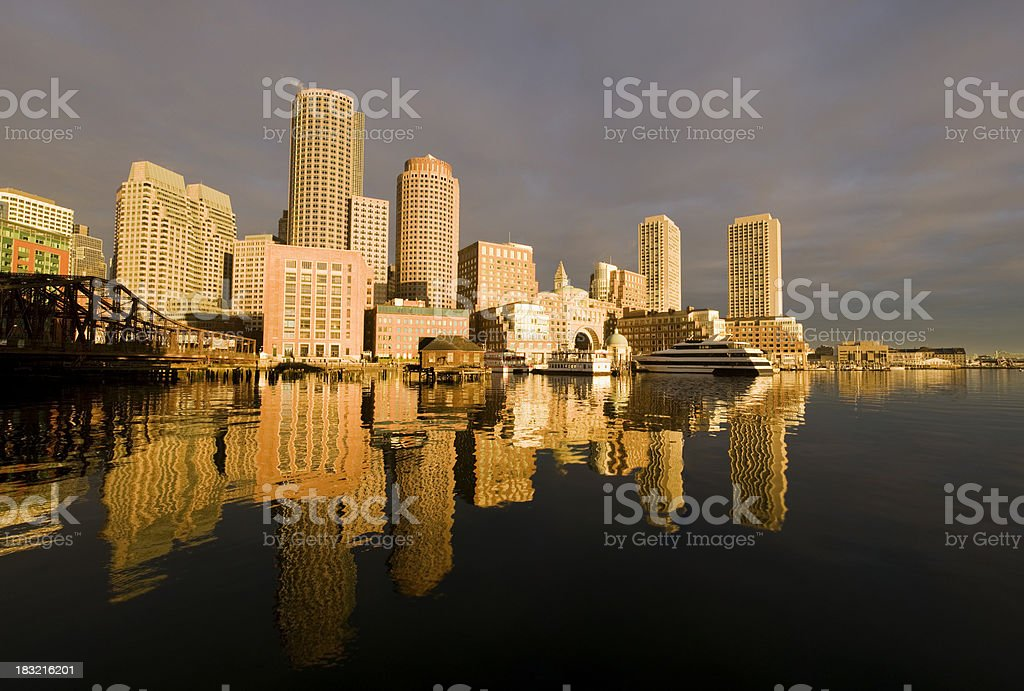 Rowe's Wharf,  Boston skyline at first light.  royalty-free stock photo