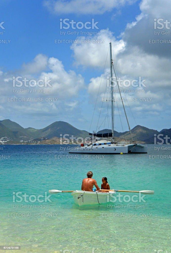 Rowing ashore on St Martin stock photo
