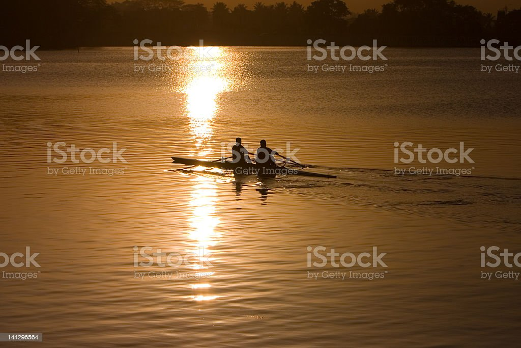 Rowing at sunrise royalty-free stock photo