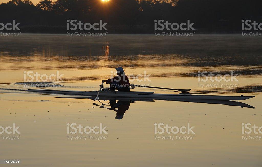 Rowing at Sunrise stock photo