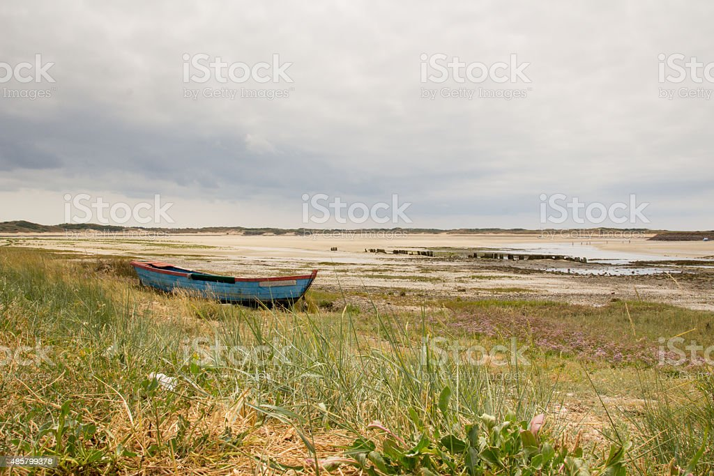 Rowing boat at low tide at La Fleuve, Normandy France. stock photo