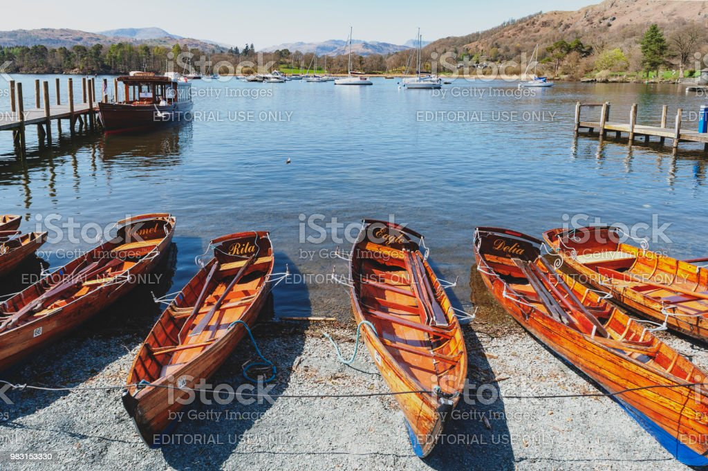 Rowing boat at Waterhead Pier in Ambleside, a lakeside town situated at the head of Windermere Lake within the Lake District National Park in England stock photo