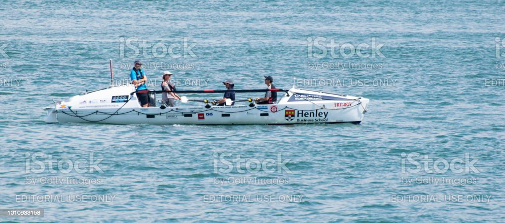 A rowing boat called Trilogy sponsored by Henley Business school rows into the Solent stock photo