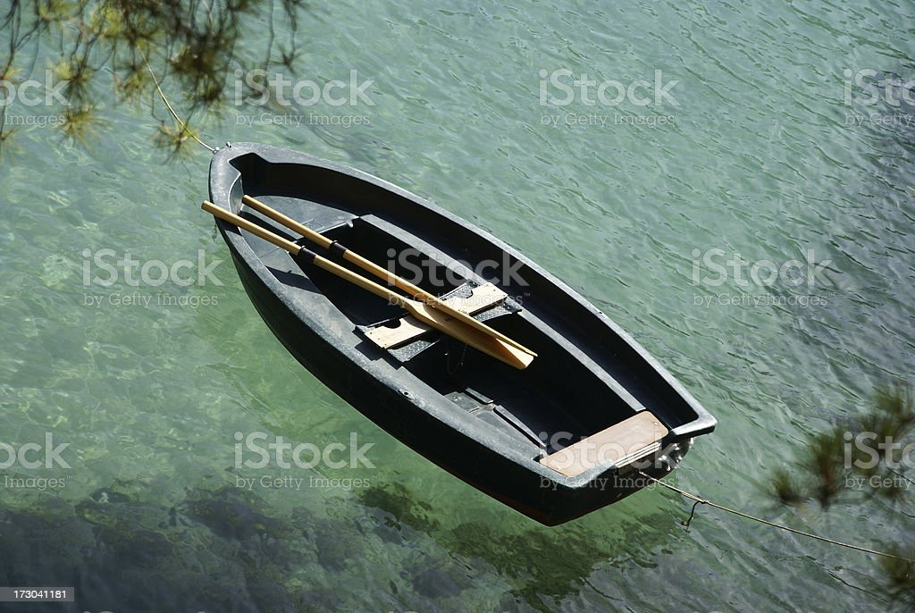 Rowing boat in a bay royalty-free stock photo